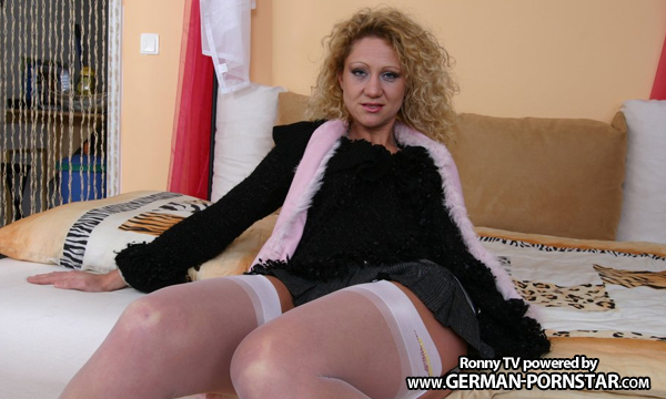 Amateur milf in a short skirt jerks and sucks a cock during 2